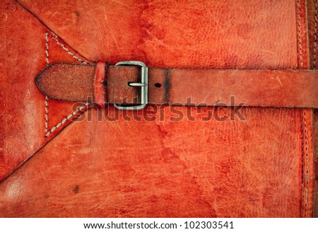 Leather vintage background with a buckle and frame
