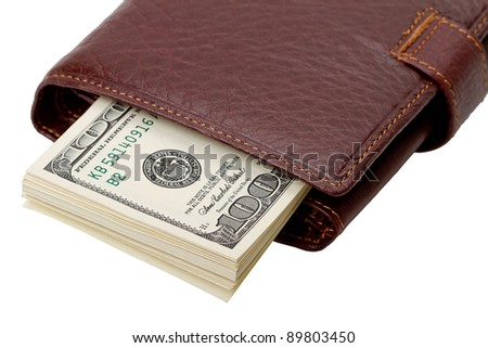 Leather wallet brown color with dollars. Isolated on white background