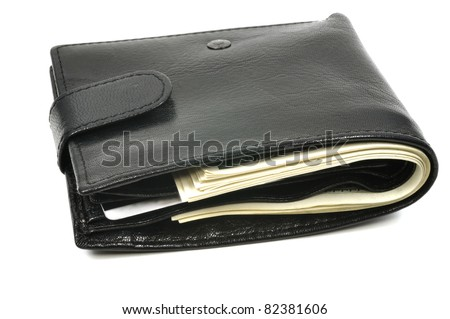 Leather wallet full of dollars, isolated on white