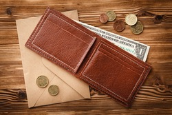 Leather wallet on a wooden background