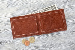 Leather wallet on white wooden background