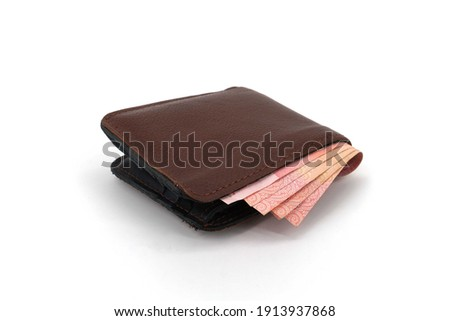 Leather wallet with banknotes inside isolated on white background.                Сток-фото ©