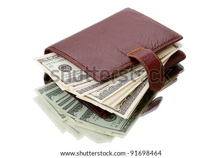 Leather wallet with dollars on the mirror table. Isolated on white background