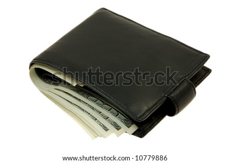 Leather wallet with some dollars inside - stock photo