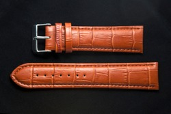 Leather watch wrist strap isolated on black