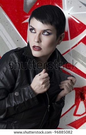 Leather woman against grafitti wall