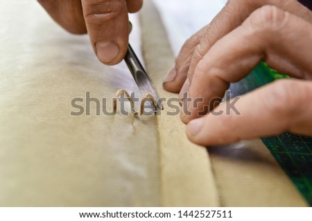 Leathercraft - Working on edge with edge skiving leather tool. Rounding the edge with edge beveler tool.
