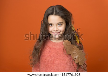 Leave haircare to professionals. Happy child wear autumn leaves in long hair. Autumn haircare. Haircare routine for fall. Seasonal changes. Haircare to avoid dry and frizzy hair. Beauty hair salon.
