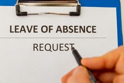 Leave of absence request on the tablet at the table.