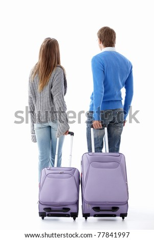 Leaving a couple of suitcases on a white background