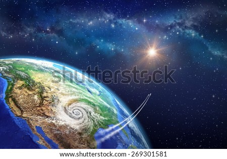 Leaving Earth. Very high definition picture of planet earth in outer space. Spacecrafts lifting off from USA soil, hit by a cyclone. Elements of this image furnished by NASA