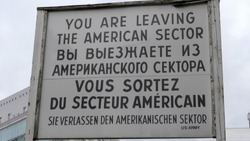 leaving the american sector sign at checkpoint charlie in berlin