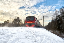 Leaving train on snow-covered railway in the winter forest