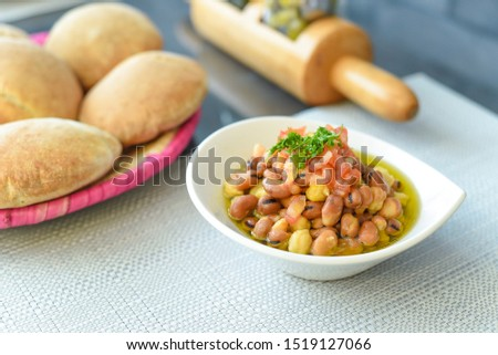 Lebanese breakfast dish known as Foul Moutabbal or Fava Beans.