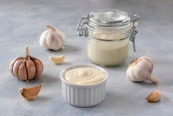 Lebanese Toum garlic sauce. All-purpose garlic sauce (no eggs) as an alternative to mayonnaise. It goes well with all dishes where garlic is appropriate. Selective focus.