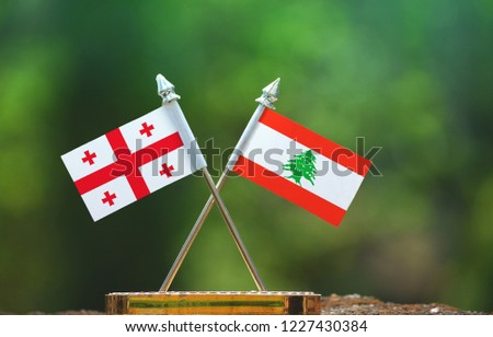 Lebanon and Georgia small flag with blur green background #1227430384