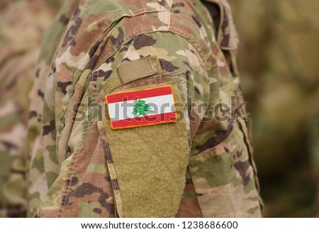 Lebanon flag on soldiers arm (collage).