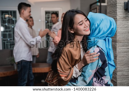 Lebaran homecoming in his hometown greet each other apologizing with friends during the Eid #1400083226