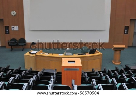 Lecture theater showing white screen. For concepts such as school and education, business and training, and meetings and conferences.