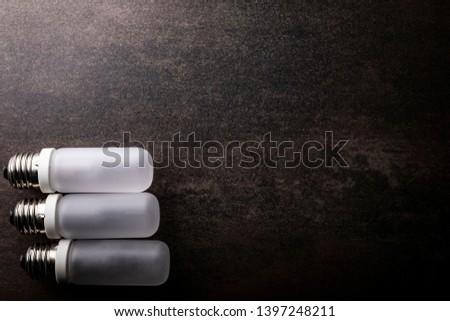 LED bulb. Composition of light bulbs on a dark background. #1397248211