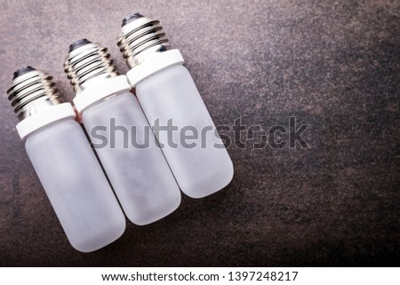 LED bulb. Composition of light bulbs on a dark background. #1397248217