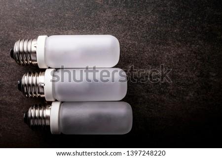 LED bulb. Composition of light bulbs on a dark background. #1397248220