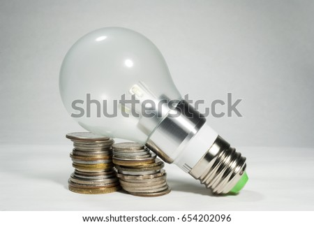 Led bulb world currencies, energy and economy #654202096