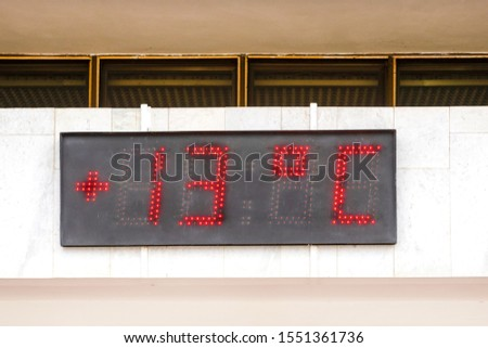 LED DISPLAY on a building facade. LED display shows the temperature. Temperature indicators on city board #1551361736