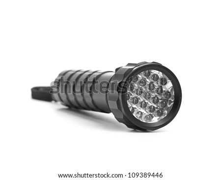 LED flashlight switched on, isolated on white