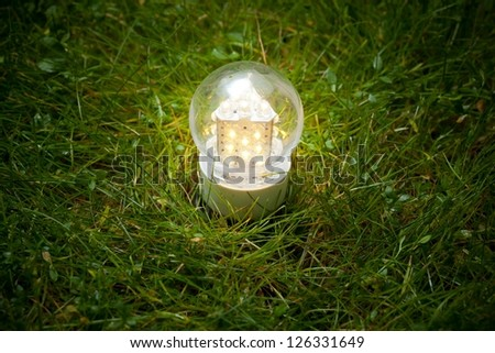 led lamp on the green grass - stock photo