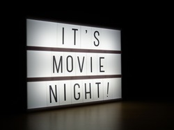 LED light box It's movie night sign in dark