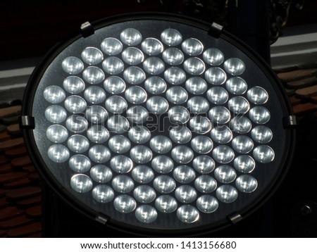 LED lighting illuminates the building.( Close-up)