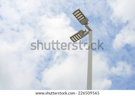 LED street lamps with energy-saving technology, cloud on sky background