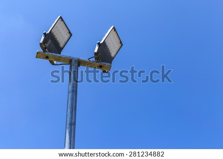 LED street lamps with energy-saving technology, on sky background