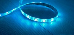 led strip in blue lies on the laminate floor/led strip light.led on the floor.blue