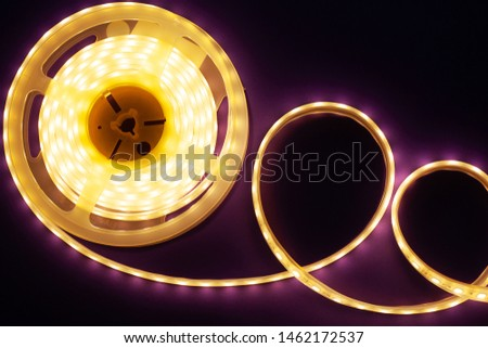 LED strip on a dark purple background, diode light close-up