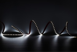 LED strip with white lighting on a dark decorative background