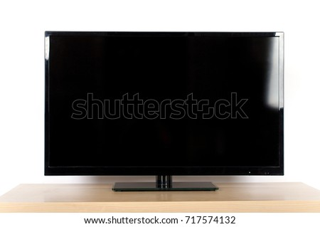 Led tv with empty black screen on a tv stand isolated on white #717574132
