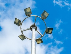 led urban lighting lamp on a pole against the blue sky, eco-friendly energy-saving technology in the urban environment