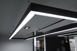 LED white cold light over workplaces. Modern office lighting.