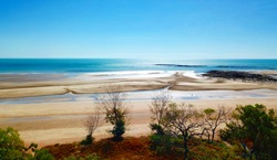 Lee Point beach at low tide. Lee Point in the  northern suburb of the city of Darwin, Northern Territory, Australia is a well-developed picnic and recreation area.