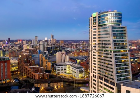 Leeds City Centre aerial view from near the train station showing offices, hotels and train station with Bridgewater Place at dusk