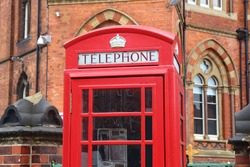 Leeds city, UK. Red telephone and Leeds General Infirmary in background.