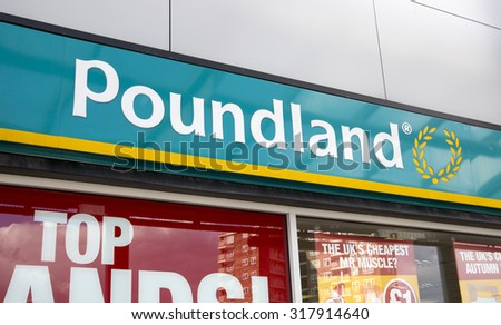LEEDS, UK - 15 SEPTEMBER 2015.  Poundland.  Sign above the entrance to the Poundland store in Seacroft, Leeds.  Poundland is a leading discount retail chain in the UK.