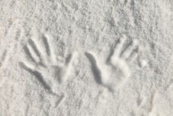 Left and right human prints in the snow.