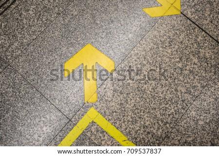 Left arrow symbol on the stone floor. #709537837