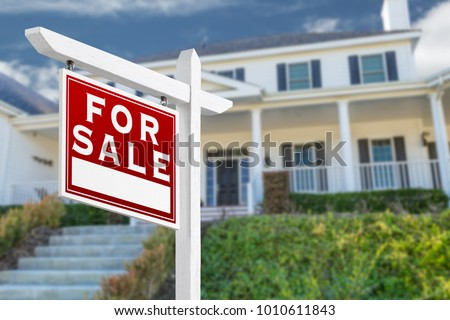 Left Facing For Sale Real Estate Sign In Front of House.