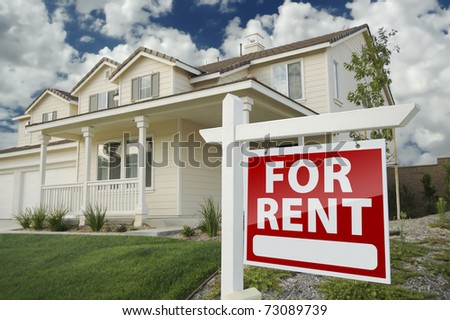 Left Facing Red For Rent Real Estate Sign in Front of Beautiful House.