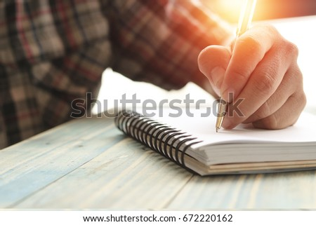 Left hand of people, student writing and note on notebook on wood table with copy space, in library, concept as education attempt and make effort to win, intend to improve knowledge for future life #672220162