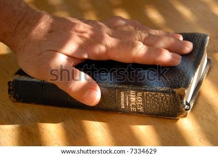 Left Hand On Bible For Testimonial Oath, Under Dramatic Light